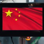 China_artificial_intelligence_disruption_everything_industry_4.0_in_global_race_ai_dominance_,_neural_network_,_deep_learning_concept._Display_robot_with_China_flag_screen_in_smart_factory.