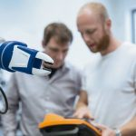industry_4.0:_two_engineer_work_at_a_robotic_arm